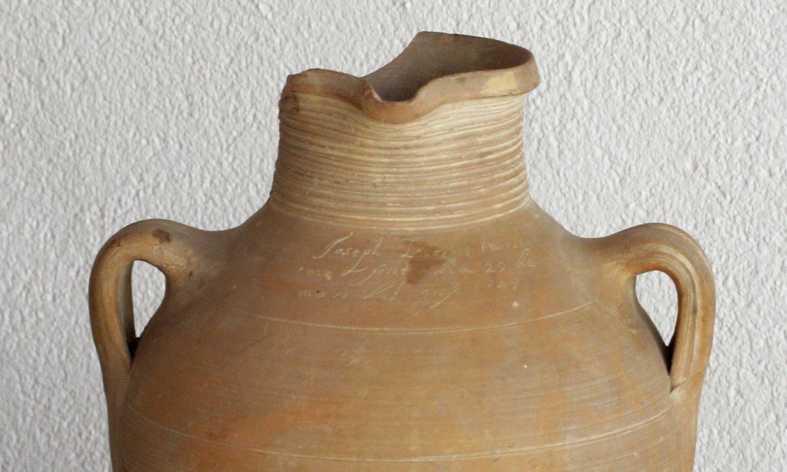 Jug. Inscription: Joseph Vicens tarricer / me fesit a dia 29 de / mars del any 1749. (Joseph Vicens Tarricer / made on 29 / March 1749) Use: wine jug.