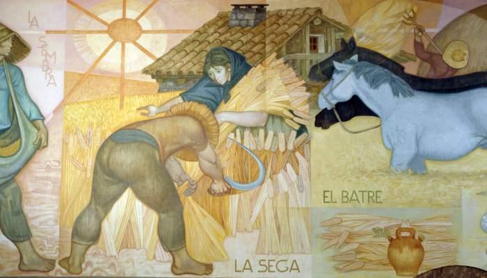 """<p><strong><span style=""""font-weight: 400;"""">Mural que representa les diverses etapes del conreu tradicional del blat</span></strong></p>"""